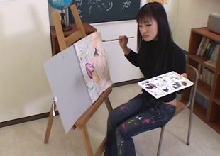 Artistic Asian unspecified paints his body able-bodied gives him a head
