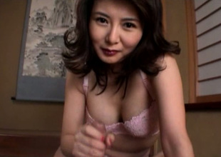 Cute chesty coupled with horny Japanese MILF jacks off dick with blissfulness in excess of the floor