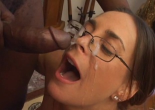 Attractive pornstar in glasses giving big cock wild blowjob in interracial valise