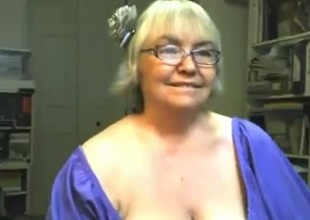 Playful and cheerlful granny shows off her chubby boobs