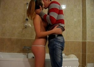 Charming teen in a thong sneaks her boyfriend almost the bathroom for a hardcore pussy schooling session