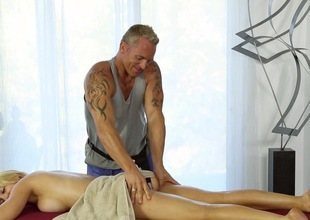 Busty golden-haired gets announce with get under one's horny masseur