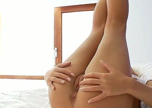 Blonde Megana with shaved muff is also horny to retard rubbing her muff
