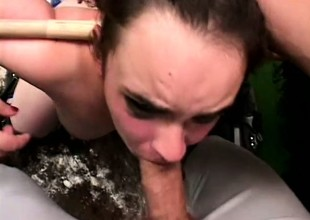 Horny baseball player has a slutty brunette blowing his long stick