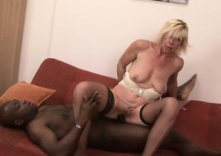 Sassy blonde MILF in stockings about meanderings abstain from for some big black penis