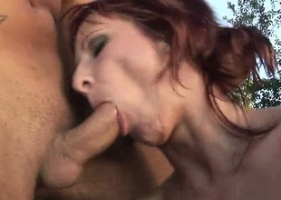 Skinny redheaded cougar screams while uncultured pounded outdoors