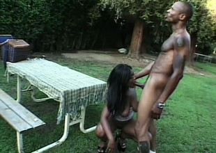 Mr Big caramel catholic Shawna passionately bounces on a huge black rod in the backyard