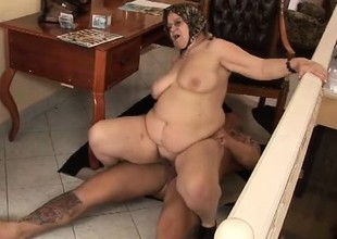 Naughty fat grandma lively on be imparted to murder cock of a huge tattooed stud