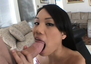 Long-haired Asian beauty makes a chap cum by bouncing on the top of his boner