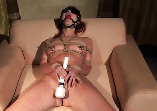 Redhead Angelina Blue blows the ham-fisted nectar out of snake