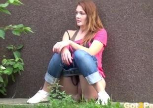 Redhead takes a piss on the sidewalk
