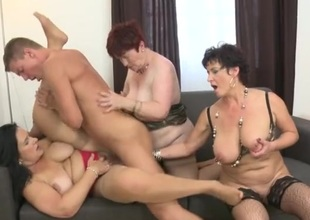 Three mature sweethearts with great tits share a young dick
